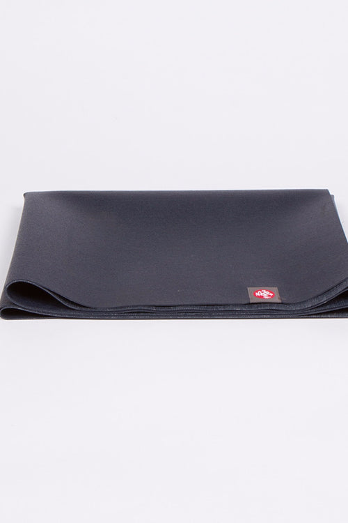 SEA YOGI // eKO Superlite yoga mat in Midnight style, only 1kg in weight by Manduka, folded image