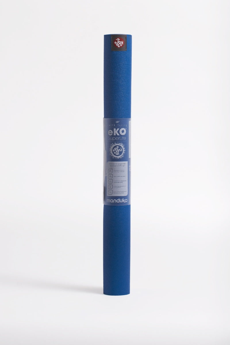 SEA YOGI // eKO SuperLite Yoga mat, only 1kg in Truth Blue style by Manduka, standing image