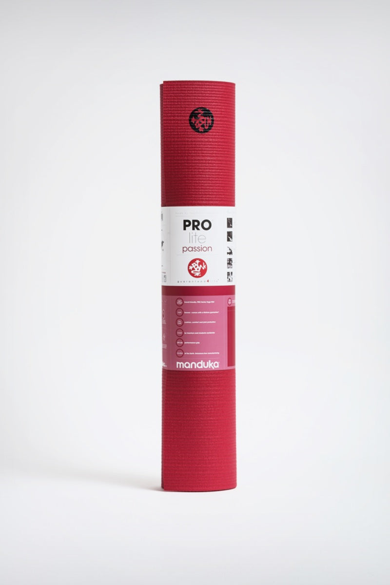 SEA YOGI // Prolite mat, 5mm thick and in Passion red style by Manduka, standing image