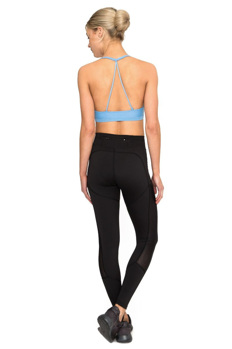 DHARMA BUMS DBX PERFORMANCE COMPRESSION LEGGING IN BLACK AND BACK IMAGE
