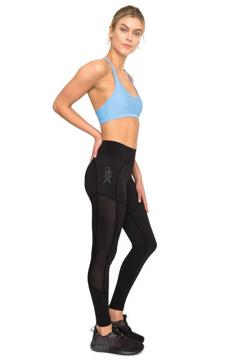 DHARMA BUMS DBX PERFORMANCE COMPRESSION LEGGING IN BLACK AND SIDE IMAGE