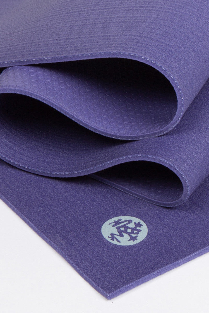 MANDUKA PROLITE YOGA MAT IN PURPLE AND CLOSE UP IMAGE