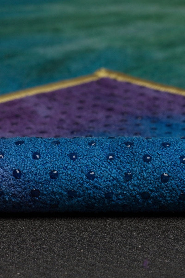 MANDUKA YOGITOES SKIDLESS MAT TOWEL IN PEACOCK STYLE AND FABRIC CLOSE UP