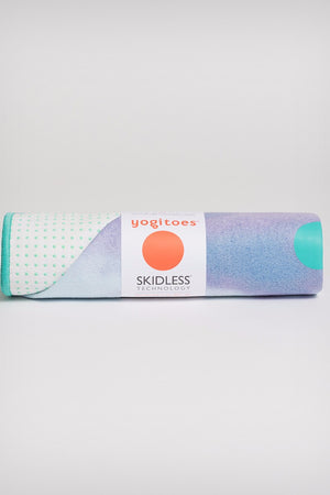 MANDUKA YOGITOES SKIDLESS MAT TOWEL IN VERTEX STYLE AND ROLLED UP IMAGE
