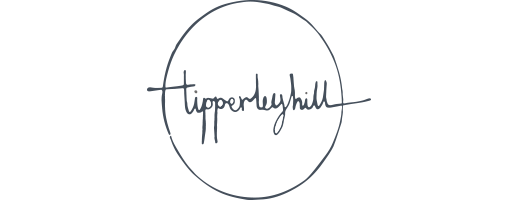 A black and white circle with the tipperleyhill signature within it