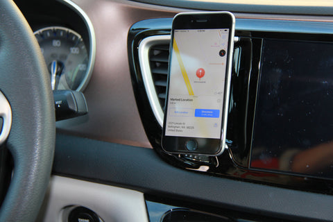 air vent mounted smartphone holder with phone attached