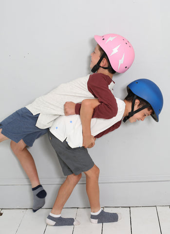 Boys playing with kid helmets on