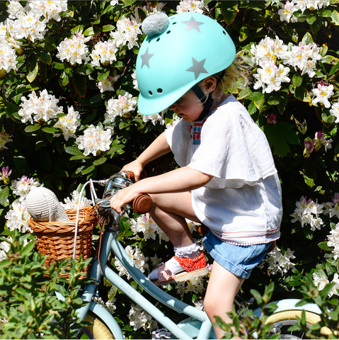 Grace riding with a Sawako turquoise star helmet