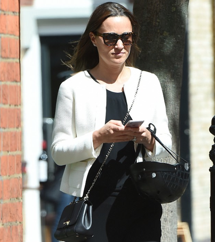 Pippa Middleton texting with Sawako helmet in hand