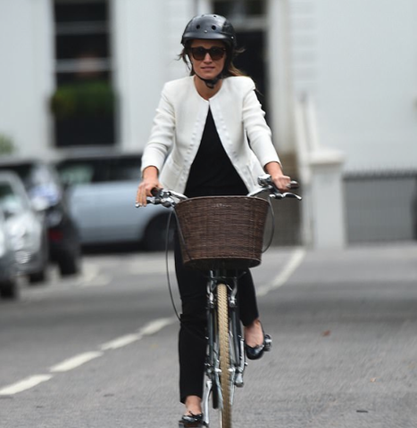 Pippa Middleton cycling with Sawako black croc helmet in London