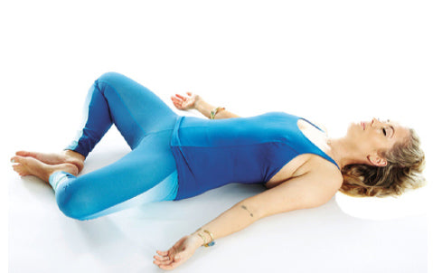 reclining butterfly yoga pose for cyclists