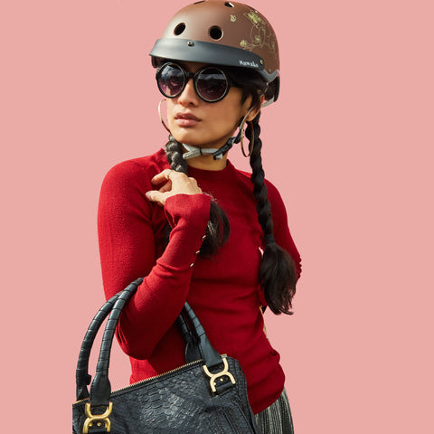 ran brown female biking helmet with red top with black croc bag