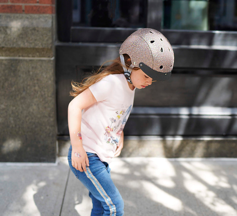 sparkle helmet on 5 year old girl skateboarding