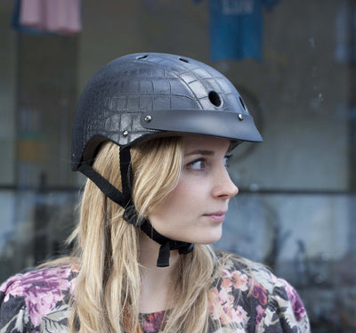 Black crocodile faux leather helmet on a model. Pippa Middleton's favourite