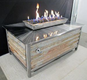 A stainless steel outdoor fireplace appliance, one of the best selling outdoor propane or natural gas clean burning gas fire pit tables by impact imports
