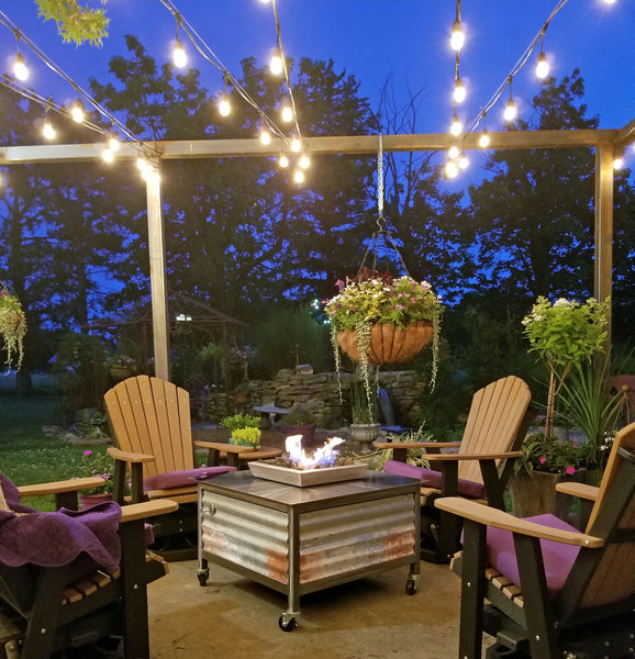 Outdoor propane or natural gas burning stainless steel square fire table located in El Dorado, Kansas.  IMPACT fire tables