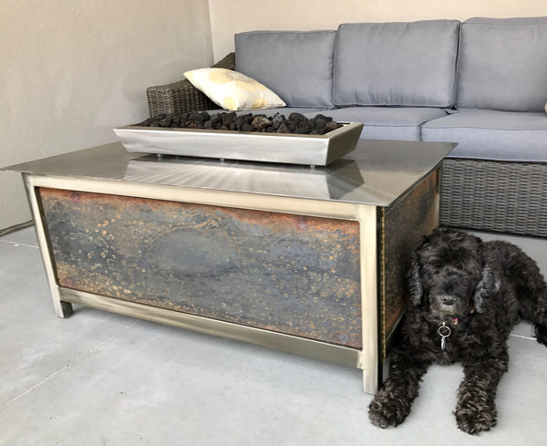 Gas Burning IMPACT Fire Table on a patio of a home in star idaho with the customer dog laying next to the stainless steel fire table