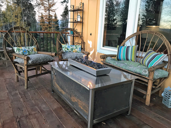 Outdoor gas burning fire pit table from IMPACT fire tables on a lakeside cabin deck on Payette Lake in McCall Idaho