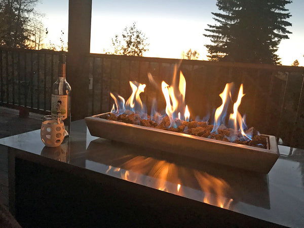 gas burning stainless steel outdoor IMPACT fire pit table at McCall Idaho Payette lake cabin