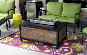 A raven black powder coated heavy duty steel rectangular IMPACT Fire Table with raw steel side panels burning propane gas made in America.
