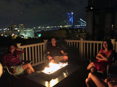 enjoying our impact gas burning fire table on our rooftop in Philadelphia Pennsylvania