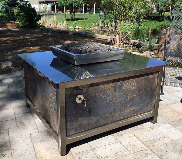 Outdoor gas burning stainless steel square fire table located in West Boise Idaho.  IMPACT fire tables
