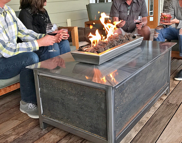 Outdoor propane or natural gas burning stainless steel rectangular fire table located in west Boise Idaho foothills.  IMPACT fire tables