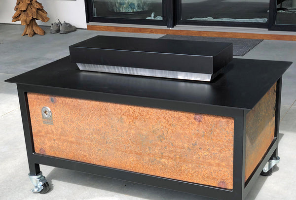 A heavy duty steel rectangular shape raven black powder coated firebox cover for a modern industrial style heavy duty steel or stainless steel IMPACT fire table to increase the overall usable table space when the fire is not burning.  Made in the USA America.