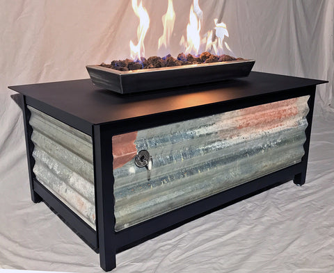 Heavy duty rectangular outdoor steel fire table with raven black frame and table top and salvaged corrugated steel side panels for burning propane or natural gas.