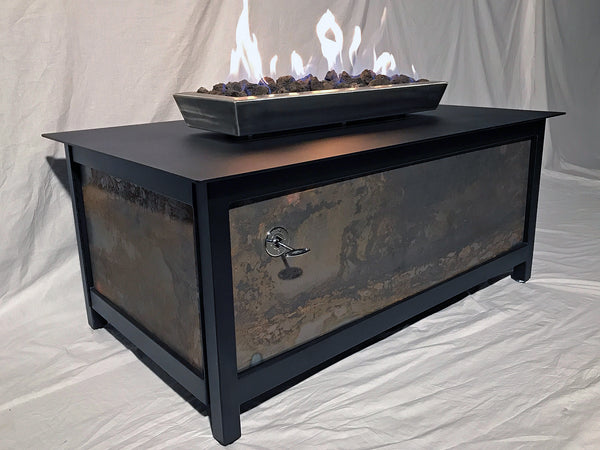 Heavy duty rectangular outdoor steel fire table with raven black frame and table top and salvaged untreated raw steel side panels for burning propane or natural gas.
