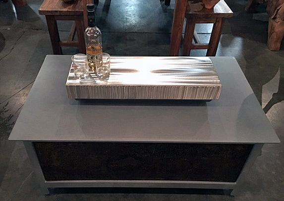 A hand brushed 304 stainless steel rectangular shape firebox cover for a modern industrial style heavy duty steel or stainless steel IMPACT fire table to increase the overall usable table space when the fire is not burning.  Made in the USA America.