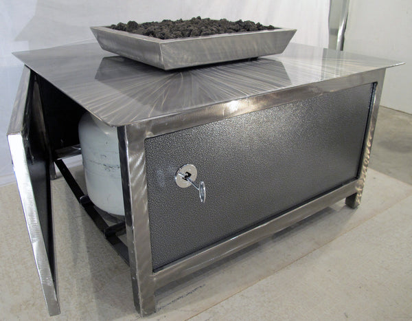 The open access door of an IMPACT Fire Table, stainless steel, hand brushed, powder coated clear, square, best firepit or fire pit, burn natural gas or propane, silver vein powder coated steel side panel option, made in USA