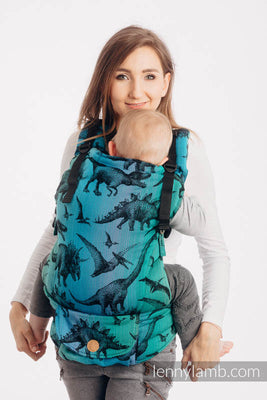 LennyUpGrade baby carrier in a dinosaur print on a blue green and purple gradient background