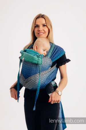 A blue, grey, and green gradient LennyLamb Meh Dai carrier in a heart weave