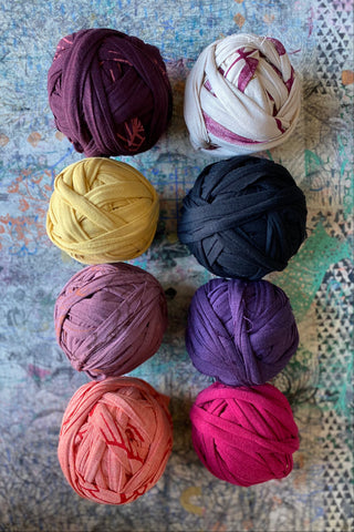 Colourful balls of Salvage Yarn made from our jersey scrap.