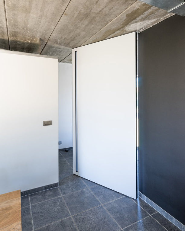 Frameless pivot door by ANYWAYdoors created with our Stealth Pivot XL hinge