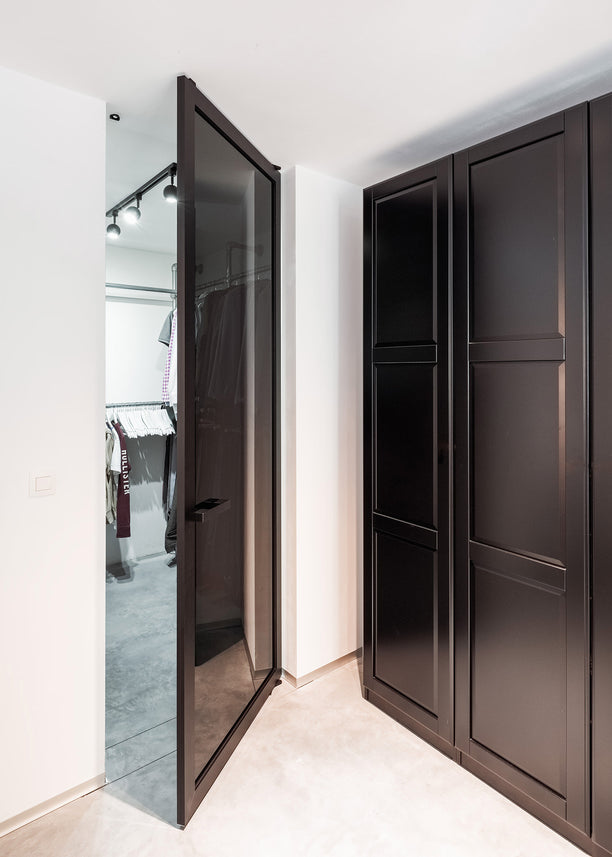 Modern glass pivot door with Dark Grey glass