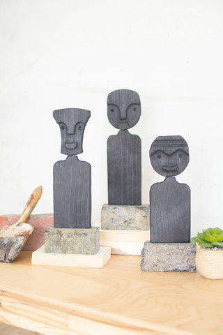 Set Of Three Black Wood Figures On Stone Bases