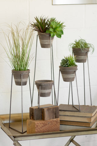 Set Of Five Clay Pots With Wire Bases