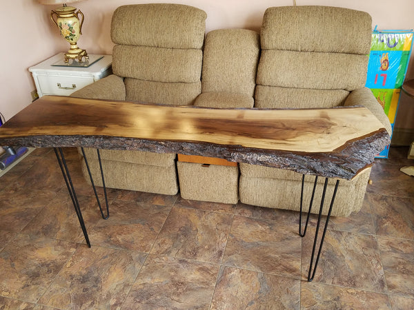 Black walnut live edge table with  hairpin legs.