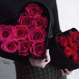 One dozen rose in heart shape gift box.
