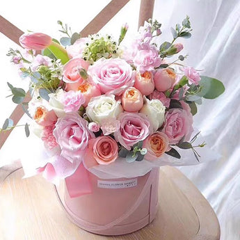 Two dozen rose in gift bucket.