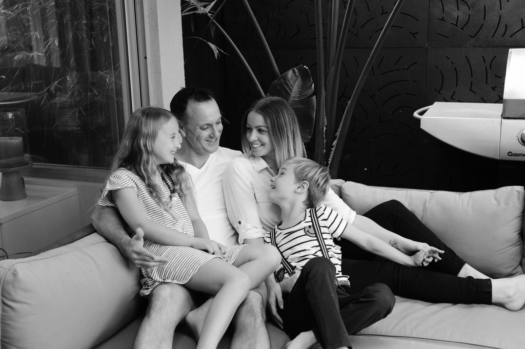 Abby, her husband Terry, and their two children Charlotte & Kobe.