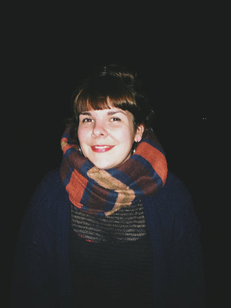 OVERSHARE series photography by Ottawa artist Julia Martin of a woman smiling with a scarf at night