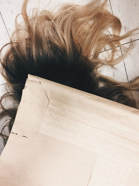 Julia Martin Photography of Hair and cardboard packaging as part of her exhibition at PDA Projects Overshare