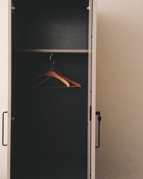 Photography by Julia Martin of a open closet door with hanger as part of OVERSHARE series at PDA PROJECTS