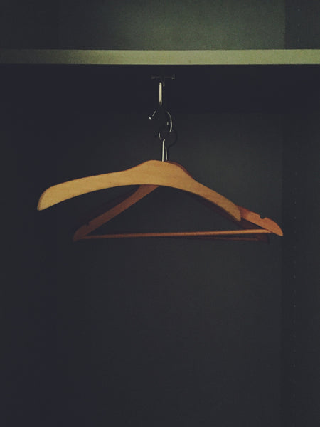 Photographic artwork by Julia Martin of hangers in a closet as part of her OVERSHARE SERIES at PDA PROJECTS