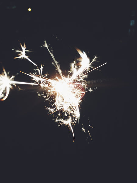 OVERSHARE series photography by Ottawa Artist Julia Martin of a lit sparkler at night