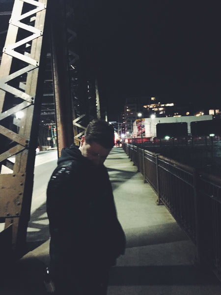 OVERSHARE series photograph by artist Julia Martin of a man at night on a bridge