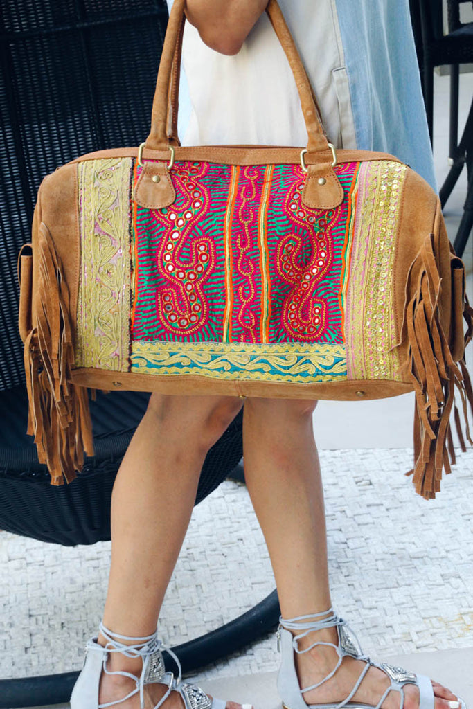 Tan Bohemian Handmade Weekender Tote with Banjara is the perfect bag to take for your next trip, holiday. Crafted by artisans with Banjara patches, the travel tote is available for women online at Aanya Hong Kong.